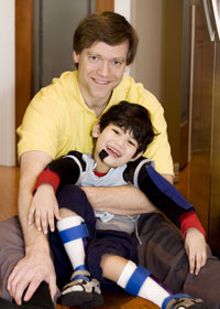 8287_little-boy-with-disabilities-and-father